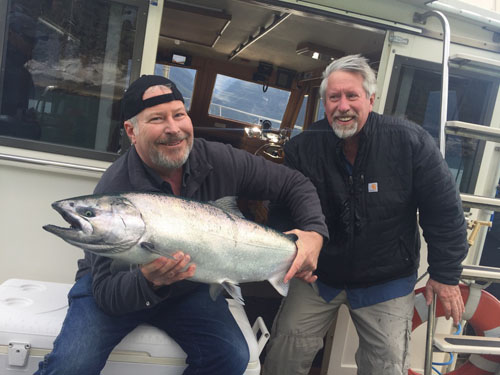 Captain Ken Gross and a happy guest with a beautiful bright Skagway King Salmon. September 2018.